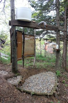 Looking for ideas on how to set up an outdoor shower for your homestead or off-grid cabin or camp? This system requires no running water for great water pressure.