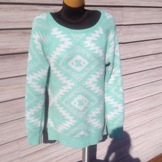 Aztec print sparkly sweater. Silver metallic sparkles all over. Looks great with leggings. Side note: Don't wear this if you're going through airport security. The metallic silver will go off and they will pat you down!!!! Size is Actually a large. But it fits really good as a slightly oversized Medium. Vanity Sweaters Crew & Scoop Necks