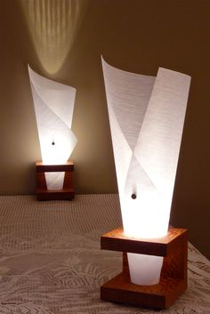 Narcis X table lamp (waterfall paper). Via Etsy. Y table lamp in background Rustic Lighting, Cool Lighting, Lighting Design, Lighting Ideas, Hallway Lighting, Ceiling Lighting, Bedroom Lighting, Ideias Diy, Wooden Lamp