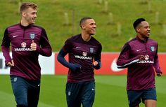 England's Calum Chambers (L), Kieron Gibbs (C) and Nathaniel Clyne (R) take part in a training session at St George's Park near Burton-on-Trent, central England, on October 7, 2014, ahead of their Euro 2016 qualifying match against San Marino at Wembley Stadium on October 9, 2014