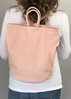 We LOVE this versatile bag! Wear as a backpack or if more room is needed secure strap behind to carry as a tote. The wide bottom makes for a roomy bag to carry a few files or books, iPad, smaller water bottle. The outside back zip pocket fits a passport perfectly. Your items are secure with the zip top. Available in several colors. #backpackforwomen #fashionbackpackspurse #fashionbackpacksbags #fashionbackpack #leatherhandbags #purse #handbags #shoulderbag #tote