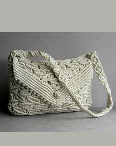 this sweet handmade vintage macrame purse  has stunning design with abstract leaf weave  beautiful medallion pattern shoulder strap  sweet
