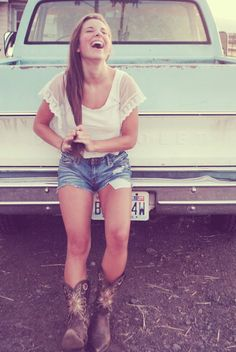 White shirt, short jeans and Cowboy Boots. Love it.