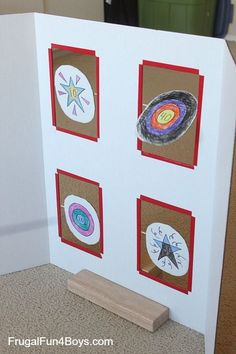 Spinning Targets for Nerf - cut squares in a display board, glue targets to bamboo skewers, and use bits of straw glued to the back of the board to hold the skewers.