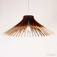 Keck Sculptural Pendant Light.  http://inhabitliving.com/products/keck-natural-sculptural-pendant-light  $165 - $185 depending on size.  Takes single 60W incandescent or 16W CFL or LED.  Cardboard.  Also comes in lighter color.