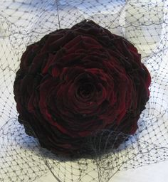 A dramatic composite (or glamelia) bouquet of black baccara roses.