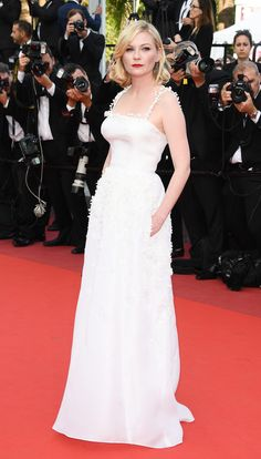 KIRSTEN DUNST in a pristine white Dior Haute couture gown with lily of the valley embroidery on the straps and bodice at the Loving premiere.