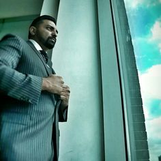 Saeed Nieves Work flow Pinstripe grey/white modern cut suit  Light blue shirt w/ white collar  Dark grey polkadot tie