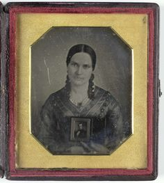 anoniem | Portrait of a Young Woman with a Daguerreotype, attributed to Mathew B. Brady, c. 1840 - c. 1860 |