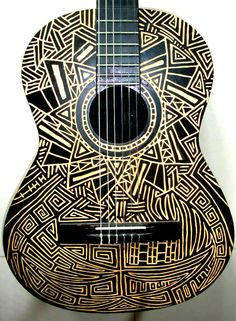 Carved Acoustic Guitar