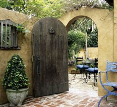 Doors separating outdoor spaces are a charming way to blur the line between indoor and outdoor living spaces.