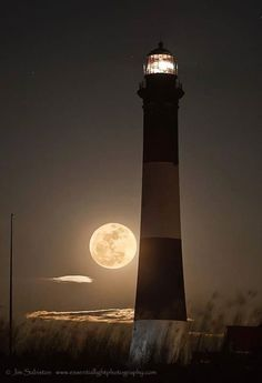 """A working Lighthouse outlined in the glorious Moon Shine of a beautiful full moon.""""casting the light of mid-day, on objects below"""" a very few clouds are gleaming in the Moon's Radiance. A beautiful photo."""