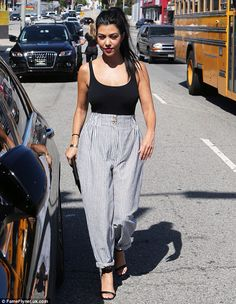 Kourtney Kardashian striped trousers