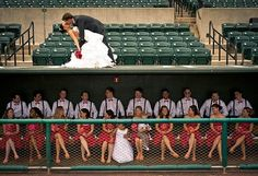 baseball diamond theme wedding bride groom pink orange ripken stadium large bridal party