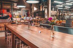 Community table dining room at Eska restaurant in Prague