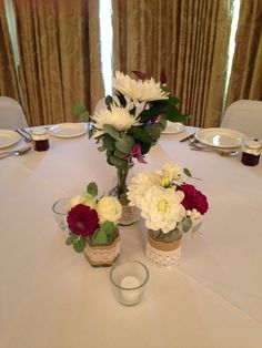 Jam jars and bottles tablecentre with Roses, Dahlias, Eucalyptus and Blooms