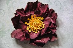 DIY Paper Flower Tutorial - could see about making these bigger or into a garland. Would be a nice way to incorporate red.