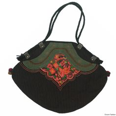 Mutlicolour thread work and traditional embroidery adds to the beauty of this large bag enough to carry to college, office or shopping. You can come up with any number of places to carry it to. Secured section with zip, well stitched and durable. Buy this trendy bag. It can be matched with your everyday attire. Buy this Trendy handbag.