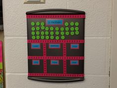 I used a $4 cookie sheet from Walmart, some 50% off ribbon from Hob Lob and some adhesive backed magnets!   Each student was assigned a number and would move the magnet to the appropriate box when he/she left the room. This way, in case of an emergency, I could glance and see who was missing and where they were!