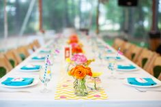 like the chevron runner with turquoise napkin/stripey straws and bright flowers ..so simple but happy!