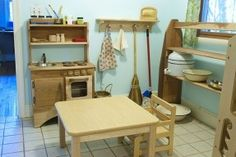 I'd like to do a litle kitchen corner like this.  We don't have room for the play kitchen, but we have a learning tower so plan to involve Isaac in the activities of the real kitchen.