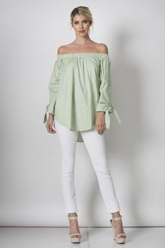 Off the shoulder top with wrist tie. 97% Cotton 3% Spandex.