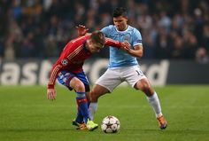 Sergio Agüero competes with Kirill Nababkin during the UEFA Champions League group D match between Manchester City and CSKA Moscow at Etihad Stadium on November 5, 2013 in Manchester, England.