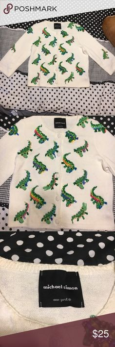 Michael Simon Sweater Who wouldn't want a 3-D alligator sweater??? This thing is so cute! Of the beads are intact. It does have a couple of spots, as shown in the photos. Fits a small/medium. Feel free to negotiate prices and save by bundling Michael Simon Sweaters Cardigans