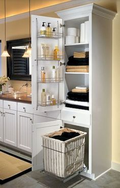 linen closet with removable hamper. probably wanna do this in the linen closet in master bathroom Laundry In Bathroom, Bathroom Renos, Bathroom Renovations, Budget Bathroom, Bathroom Vanities, Tall Bathroom Cabinets, Laundry Rooms, Simple Bathroom, White Bathroom