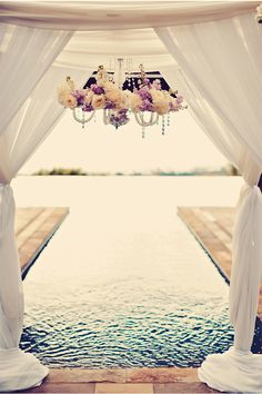 Gorgeous Examples of Chandeliers Used in Weddings / Tamiz Photography / via StyleUnveiled.com