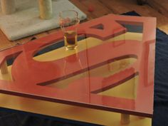 Hand made Superman Shield End Table. Each table is made and painted when you agree to buy. This unique dual layer end table is sure to stand out Superman Room, Superman Art, Superman Gifts, Superhero Room, Dark Wood Stain, Man Of Steel, Wood Glue, Cut Glass, End Tables