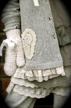 Dorothea's Eventyr. Lace peeking from underneath, crochet on top, bow woven in--yes! I had a great aunt who embellished coats, and most other things too, with crochet trim. Spectacular effect.