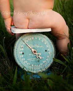 We have an old baby scale (not quite as wonderful as this one, but kind of cute).  I'll have to see if she'll sit on it during our photo shoot this week!