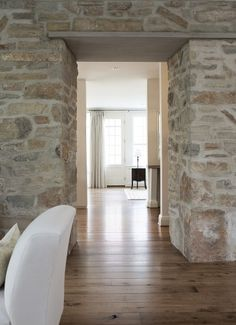 This stone doorway really lightens up this space! This stone doorway really lightens up this space! Stone Interior, Interior Walls, Wood Plank Flooring, Stone Flooring, Plank Walls, Fresh Farmhouse, Brick And Stone, Faux Stone, Stone Houses