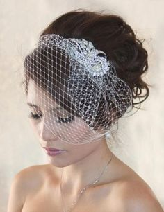 Sparkly Birdcage veil for wedding and special occasion. This birdcage veil is made with Russian netting and Swarovski crystal rhinestones brooch.