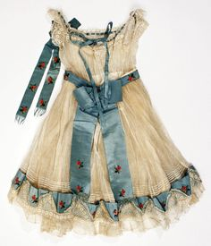 1864 American cotton and silk child's dress with cotton over bodice. (back view)