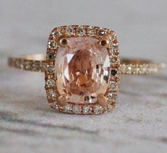 my dream ring. peach sapphire + diamond halo + rose gold. different from the rest, stunningly beautiful.