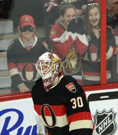"""Fans looks on as Ottawa Senators goalie Andrew """"The Hamburglar"""" Hammond skates during the warmup before NHL hockey game action against the Boston Bruins, Thursday, March 19, 2015, in Ottawa, Ontario. (AP Photo/The Candian Press, Adrian Wyld)"""