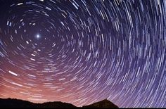 This long-exposure photo (left) shows how the North Star, Polaris, stays fixed in the night sky as other stars appear to move during the night due to Earth's rotation. At right, a close-up of the multi-star Polaris system.