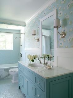 Paint Color: Benjamin Moore HC-149 Buxton Blue.  This bathroom features custom designed vanity in blue (Benjamin Moore HC-149 Buxton Blue) with glass knobs, bubble tile accent wall and floor and wallpaper above wainscot.  The wallpaper is available through Cowtan and Tout.   The bathroom is 5′ x 12′ with a 5′ vanity. Bathroom Renos, Bathroom Interior, Small Bathroom, White Bathroom, Bathroom Ideas, Small Tub, Bathroom Vanities, Bathroom Designs, Coastal Bathrooms