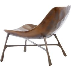 Shop bordeaux chair.   Tailored chair makes a striking first impression while offering sheltering comfort.  Handmade metal shell-shaped base with organic crossed legs brings an updated midcentury vibe to any living space.
