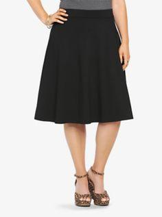 Plus size skater skirt in black for Mickey Mouse bounding.