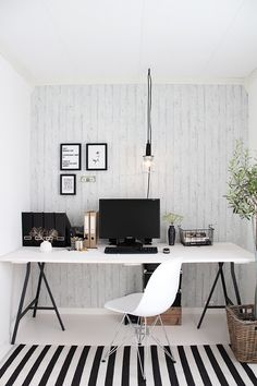 Simple Scandinavian office. Lovely. I would have one brightly-colored accessory and an animal figurine to bring it to life.