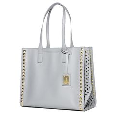 We've let the sunshine into our neutral gray tote by adding a bold yellow lining. Add to that on-trend cutouts on both sides, and it's the best fair-weather friend ever!  #AvonRep #avon_valerie vnesnah.avonrepresentative.com