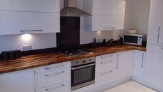 Walnut worktops look excellent alongside modern glossy white kitchen units. White Kitchen Cupboards, Walnut Kitchen, Kitchen Worktop, Kitchen Units, Kitchen Tops, New Kitchen, Ivory Kitchen, Kitchen Ideas, Kitchen Room Design