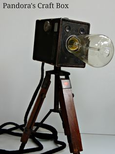 Vintage camera tripod lamps by Pandora's Craft Box, featured on I Love That Junk