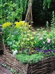Raised Beds: Raised beds made of woven willow hurdles give a garden a cottage-style look. (DK - How To Grow Practically Everything