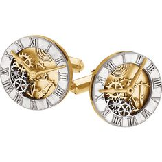 A pair of 14 karat yellow gold and sterling silver clock design cuff links. These round, two tone, clock face cuff links will have you watching time fly by! They measure 19.5mm x 9.5mm and weigh 19.81 grams. Allow 1-2 weeks delivery.