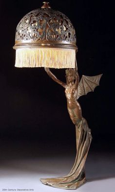 An Art Nouveau bronzed metal table lamp probably Austrian circa 1900 of a winged nymph, after a model by R. With pierced scrolling filigree bronze shade. Antique Lamps, Antique Lighting, Vintage Lamps, Antique Art, Lampe Art Deco, Lampe Retro, Jugendstil Design, Art Nouveau Furniture, Furniture Nyc