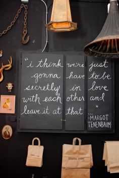 i am loving everything about this. chalk on cabinet doors and the quote.